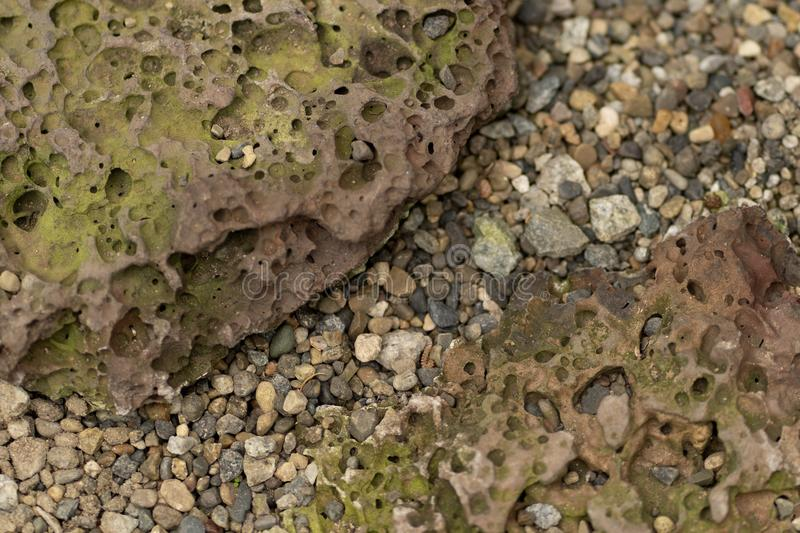 Photo texture of natural porous stone and gravel royalty free stock images