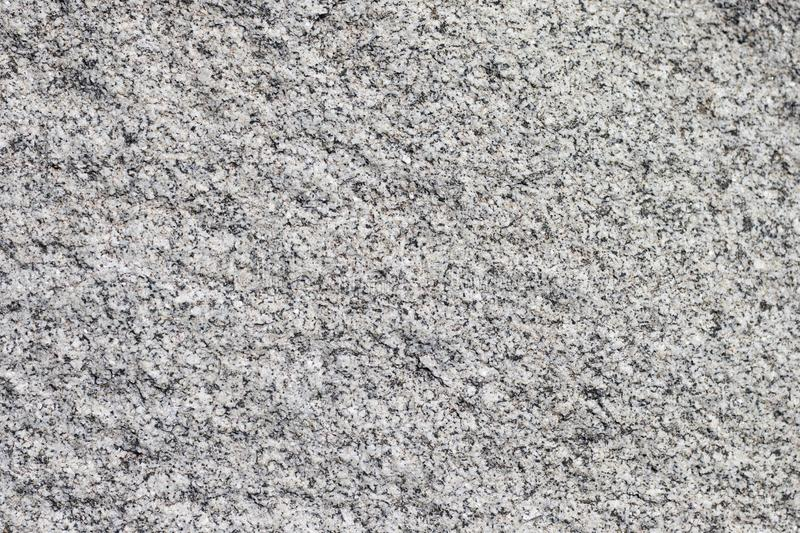 Texture natural smooth stone. Background natural stone with gray and brown royalty free stock image