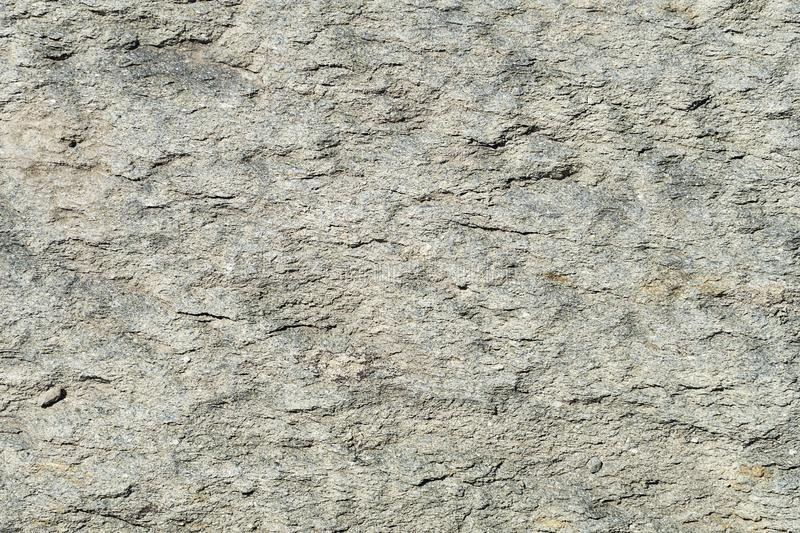 Texture of natural stone gray. Background stone with a shallow relief stock photography