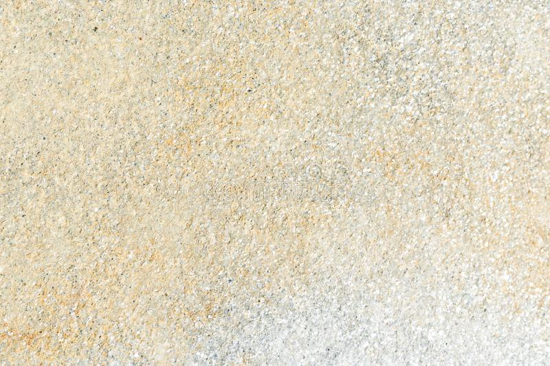 The texture of natural stone is yellow. Background stone with yellow stock photography
