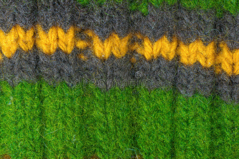 Texture natural wool knit pattern. Multicolored texture with natural wool knit pattern royalty free stock photos