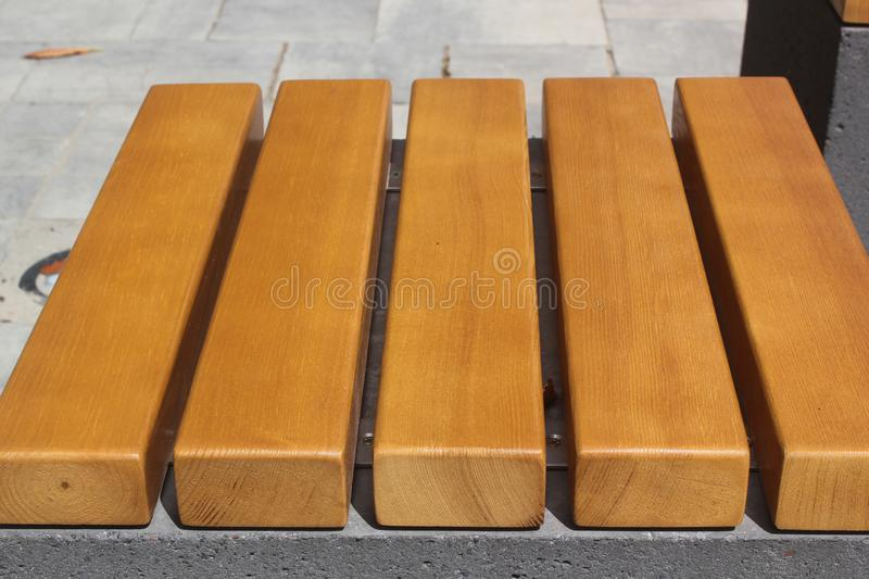 Texture of new varnished wooden slats. Square bench seat royalty free stock images