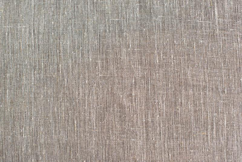 Texture o fundo da tela da lona na luz - cor bege marrom fotografia de stock