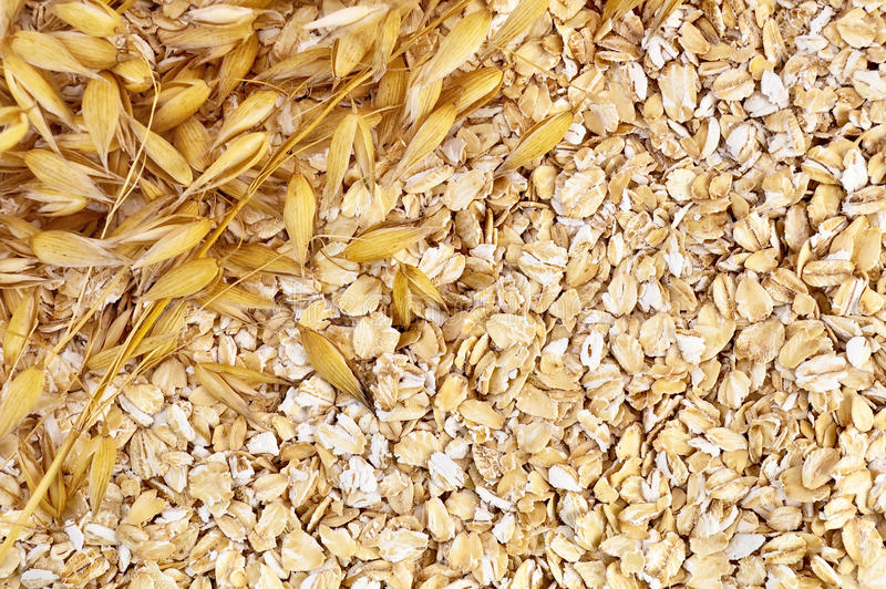 The texture of oatmeal with oat stalks left stock photography