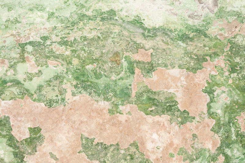 The texture of the old antique wall is green, there are fractures of the white protective layer of plaster from the effects royalty free stock photos