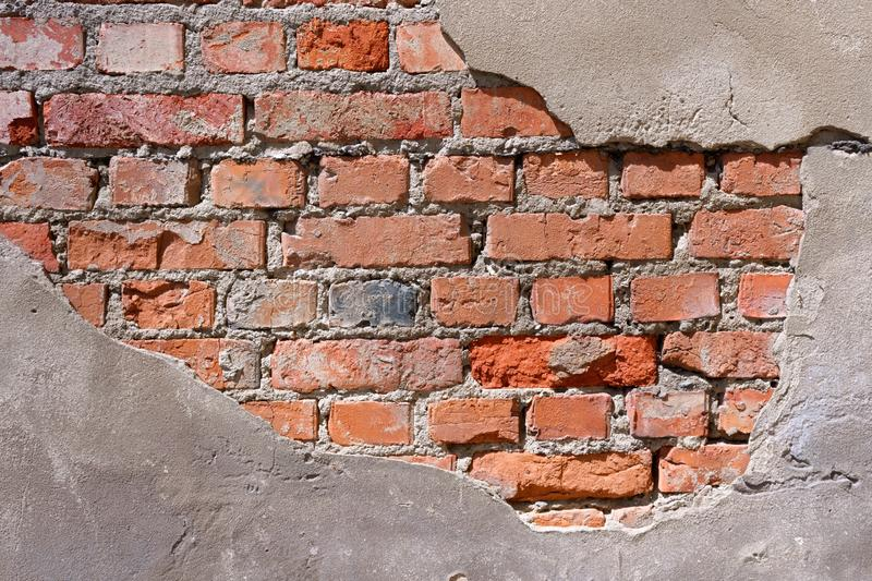 Brick texture with scratches and cracks. Old brick wall pattern royalty free stock photos