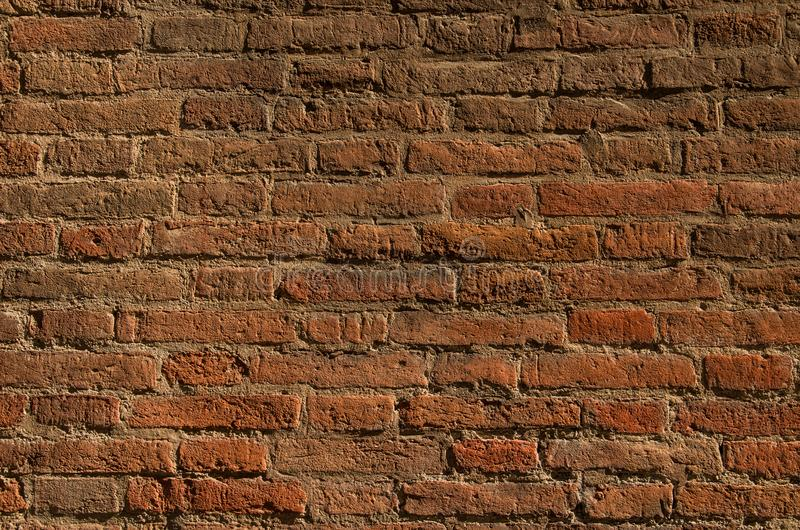 Texture of an old brick wall in contrast lighting. Natural background.  stock image
