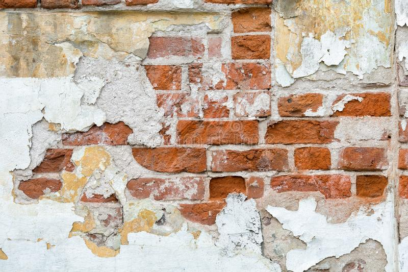 Texture of a old brick wall with traces. Of gray plaster stock photo