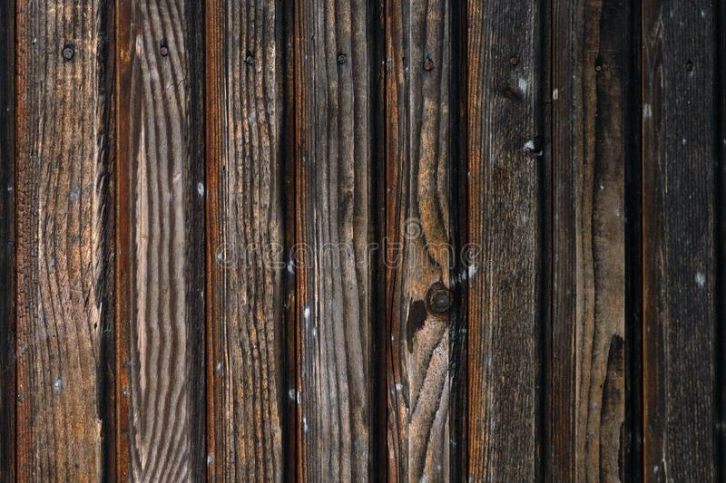 Texture of the old burnt in fire wooden boards stock image