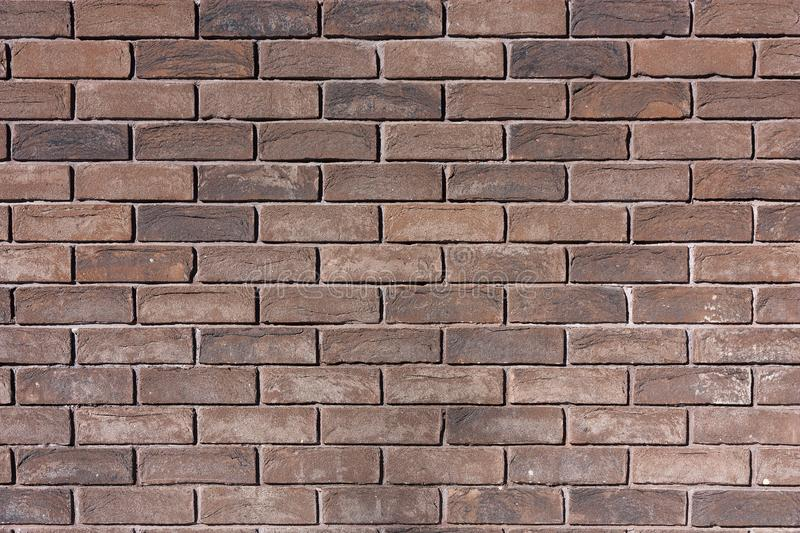 Texture of the old closeup brown brick wall royalty free stock image
