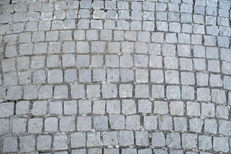 Texture of old Cobbled Pavement close-up. stock image