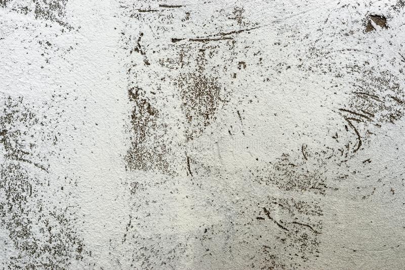 Texture of old concrete wall painted white. The texture of an old concrete wall painted white. grunge background retro vintage concrete paint royalty free stock photography