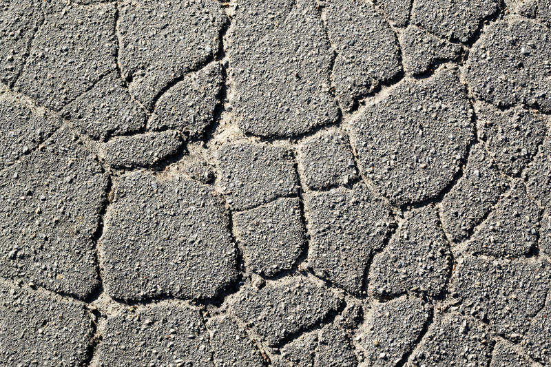Texture of old cracked asphalt in the daytime II stock photography