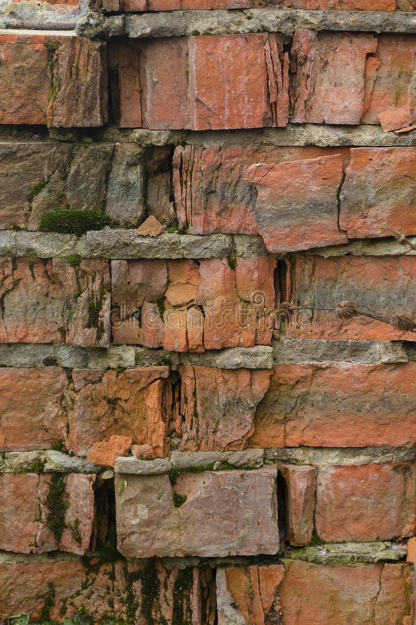 Texture Of Old Crumbling Brick Wall. A crumbling old red brick wall background texture in shallow depth of field. stone wall selective focus stock photos