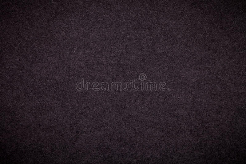 Texture of old dark brown paper background, closeup. Structure of dense black cardboard royalty free stock photo
