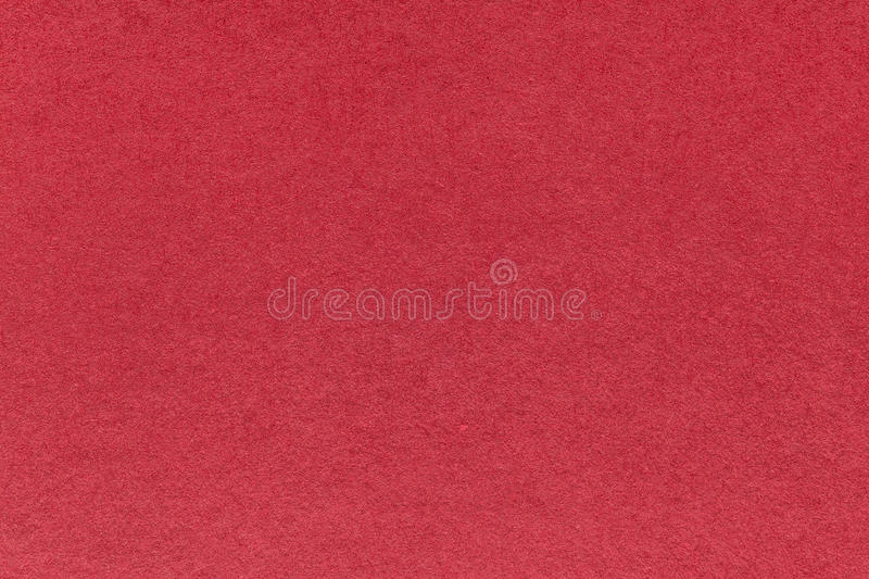 Texture of old dark red paper background, closeup. Structure of dense wine cardboard. royalty free stock photography