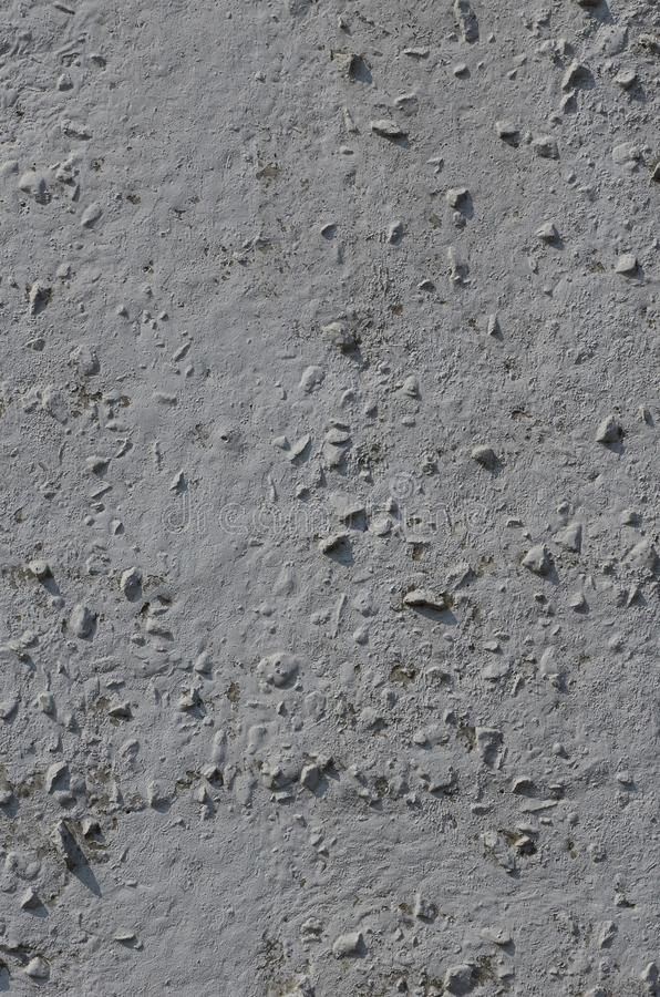 Texture of the old embossed concrete wall in gray color. Background image of a concrete produc stock images