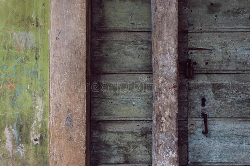 Texture of an old front door. The texture of an old fron door and wall at Vboska, Croatia stock images