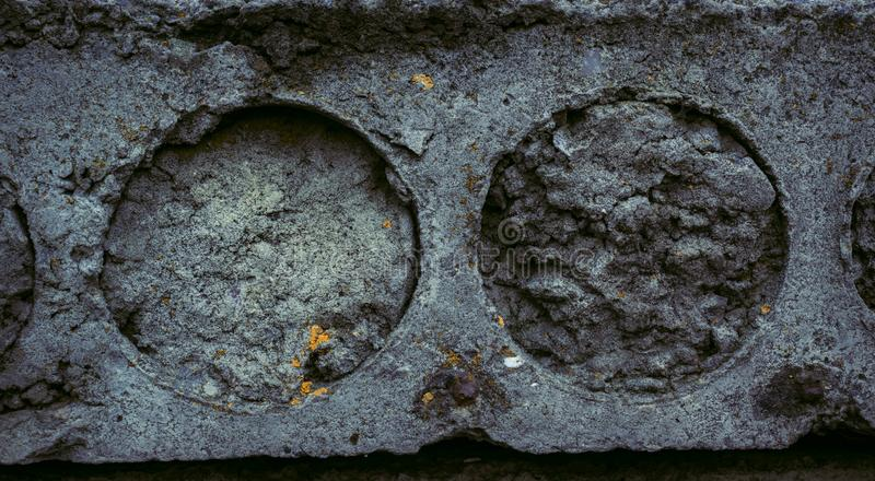 The texture of the old concrete stone slab with cracks irregularities and circles. Grunge Style Wallpaper royalty free stock photography