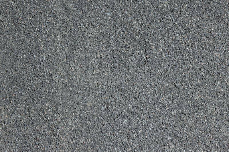 Texture of the old gray dusty asphalt on a Sunny day royalty free stock photography