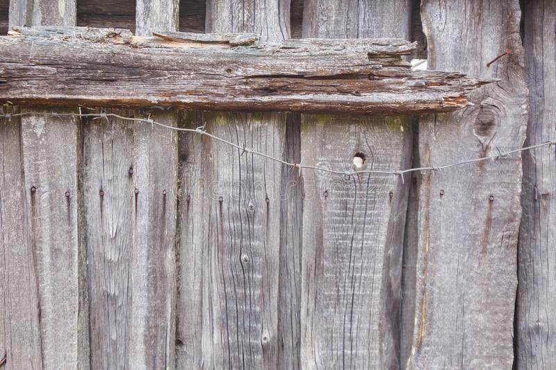 Texture of old gray fence and barbed wire royalty free stock images
