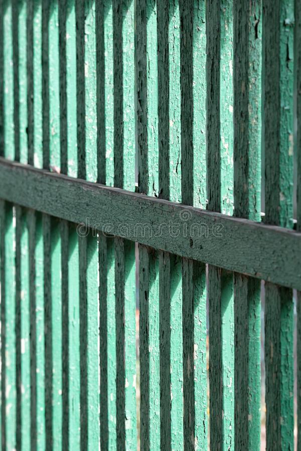 Texture of an old green fence from a fence. Close up stock photography