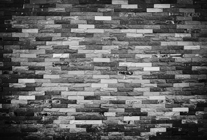 Texture of old grunge brick wall background. Black and white pic royalty free stock photo