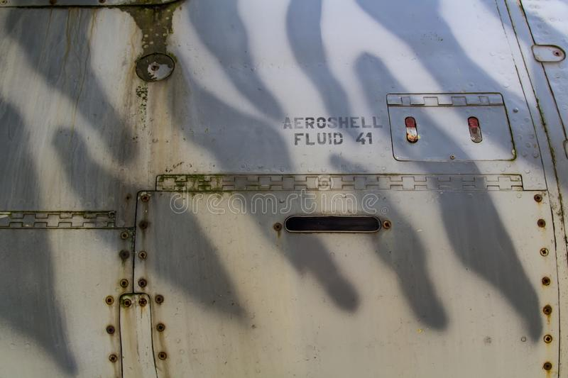 Texture of old jet plane with tiger camouflage and Aeroshell fluid reservoir.  royalty free stock photo