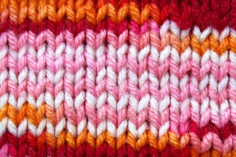 Texture old knitted surface warm red shades royalty free stock photos