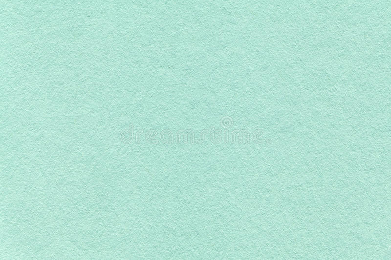 Texture of old light cyan paper background, closeup. Structure of dense turquoise cardboard.  stock photos