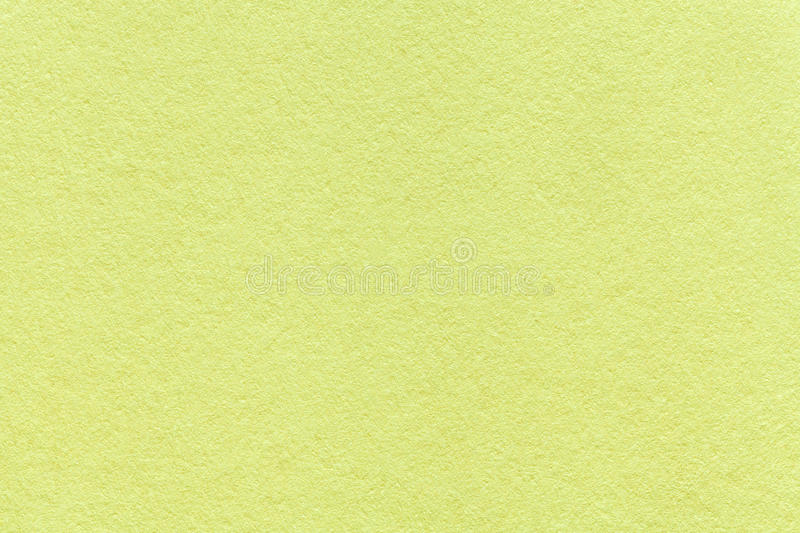 Texture of old light green paper background, closeup. Structure of dense olive cardboard stock images