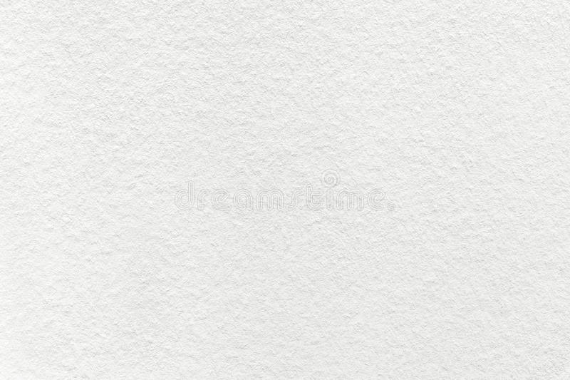 Texture of old light white paper background, closeup. Structure of dense cream cardboard royalty free stock image