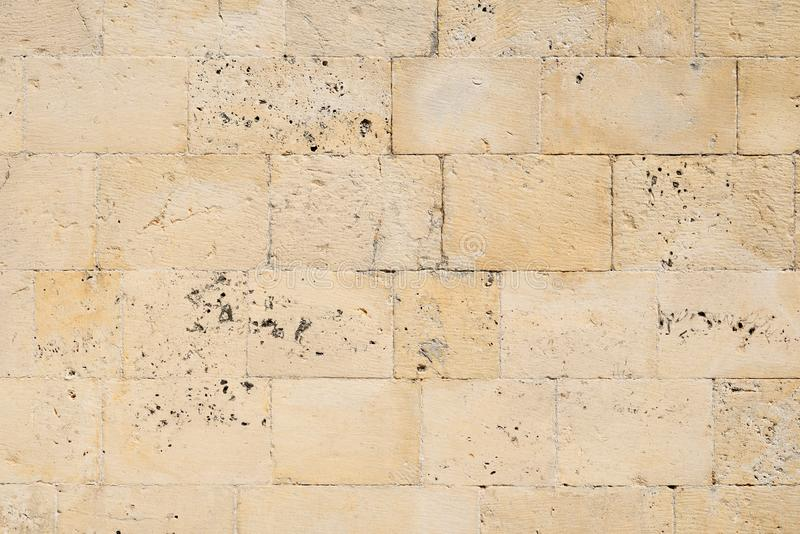 Old limestone brick wall. Texture of old limestone brick wall royalty free stock images