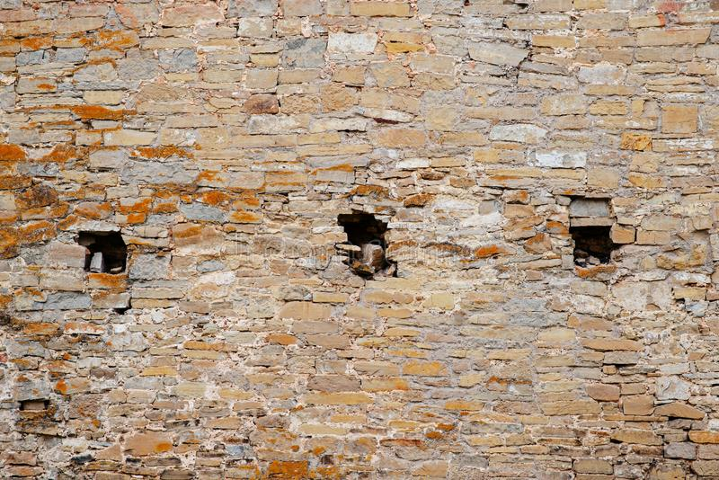 Texture of old medieval castle wall with loophole made from gray stones royalty free stock photo