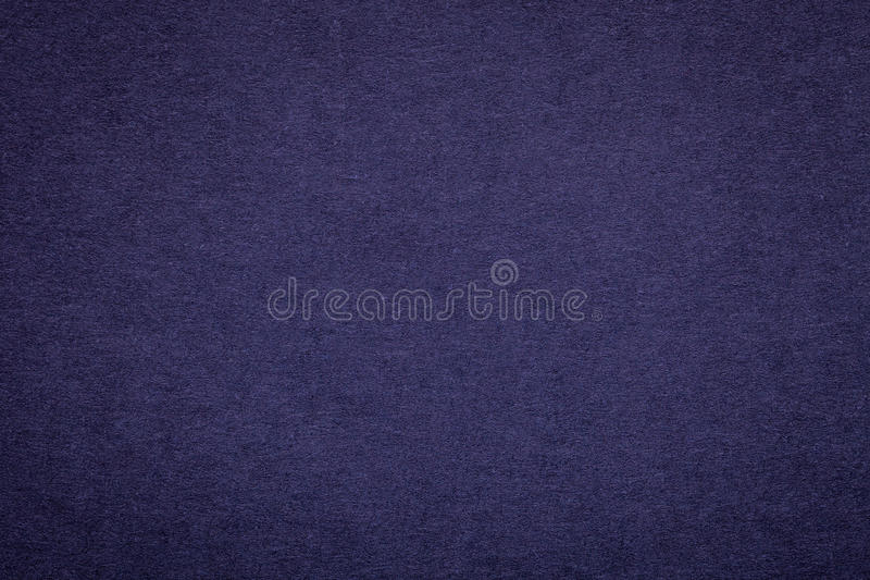 Texture of old navy blue paper background, closeup. Structure of dense dark denim cardboard stock images
