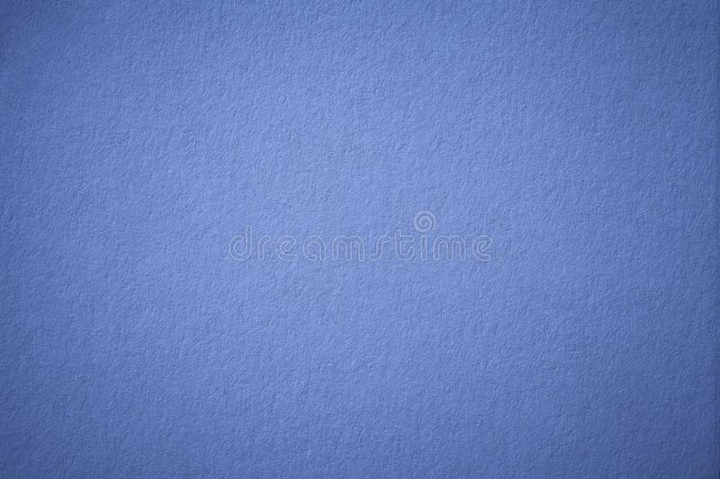 Texture of old navy blue paper background, closeup. Structure of dense dark denim cardboard. royalty free stock photos
