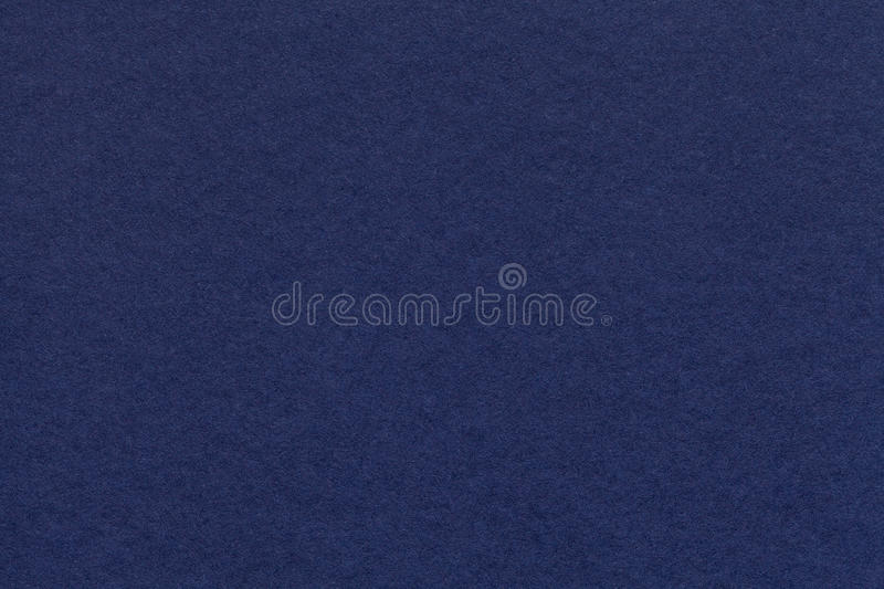 Texture of old navy blue paper closeup. Structure of a dense cardboard. The denim background. stock images