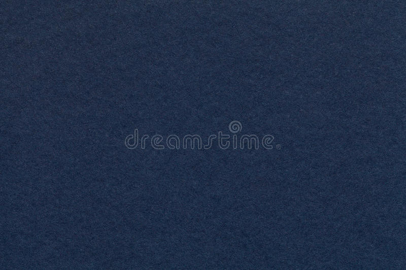 Texture of old navy blue paper closeup. Structure of a dense cardboard. The denim background. stock photo