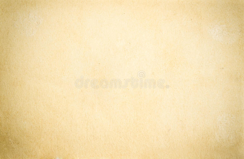 Texture of old paper. Background texture of old faded yellow paper