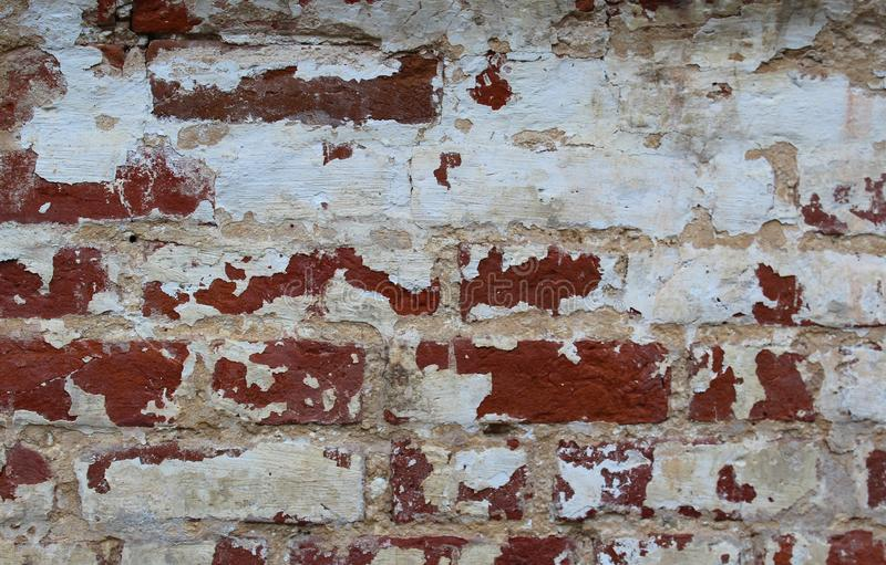 Texture old peeling brickwork of red brick stock photography