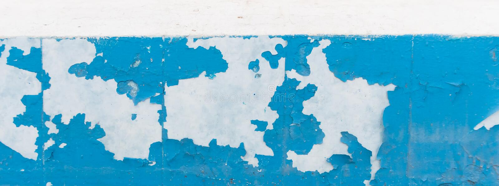 Wall with old peeling blue paint. Texture of old peeling paint, vintage graffiti background, it`s time to make repairs, cracked paint texture.  Clipart stock photos
