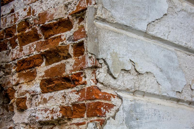 Texture of old red brick wall. Grunge background brick wall. White painted rough wall surface. The corner of the building.  royalty free stock photography