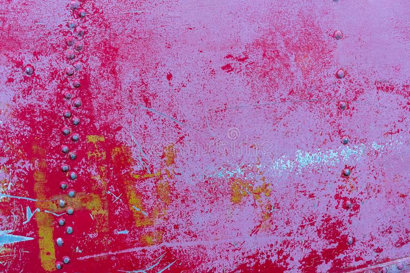 Texture of old red painted weathered steel board with several layers of paint with cracks.  stock image
