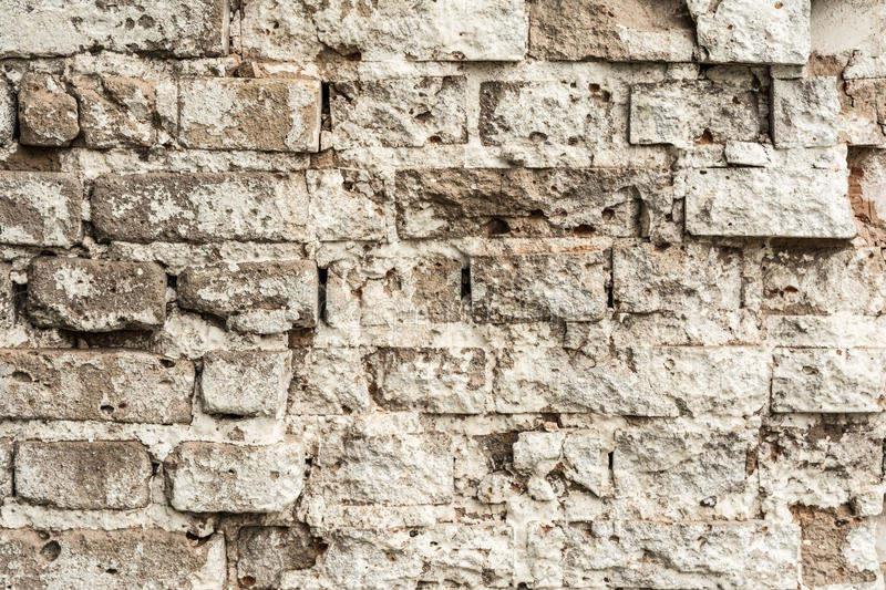 Texture of an old ruined brick wall of an ancient building stock photos