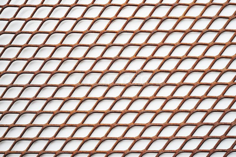 Texture of old rusty expanded metal on white background,  metal expanded lath. Texture of old rusty expanded metal on white background, metal expanded lath stock image