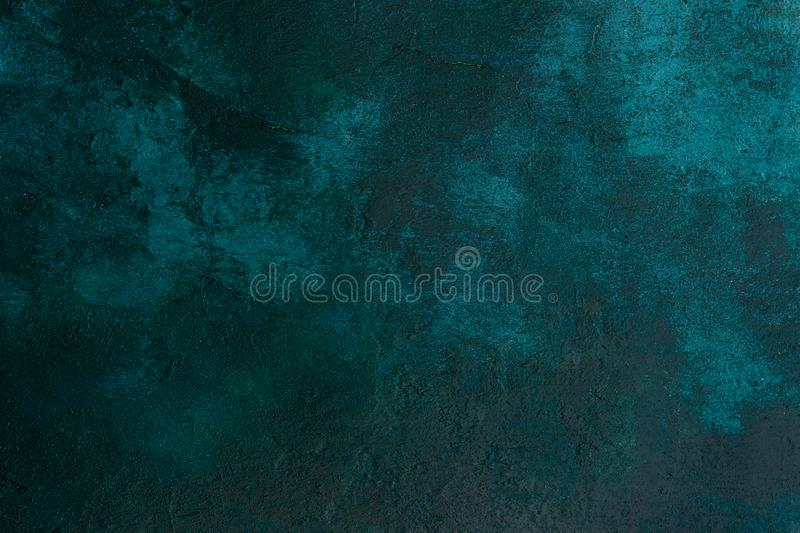 Texture old stone concrete wall dark green color with cracks , background royalty free stock images