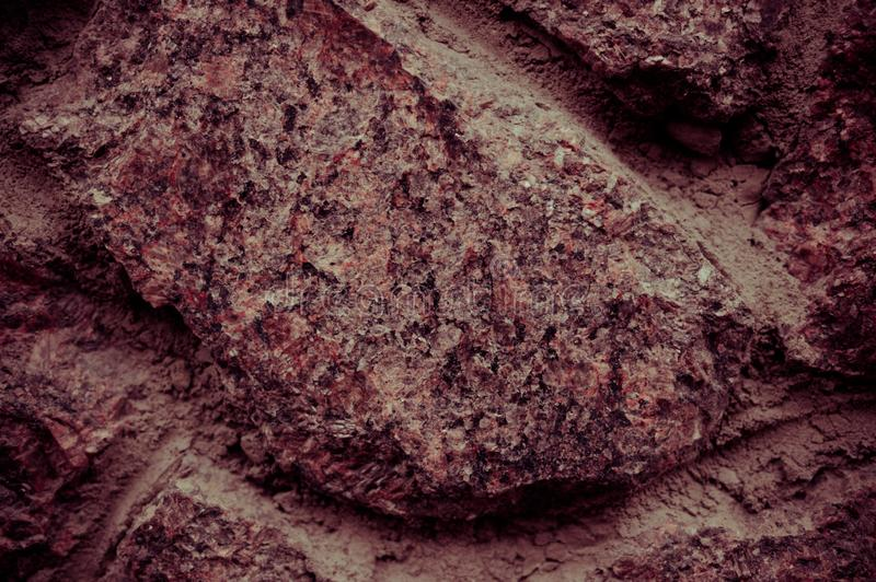 Texture of old stone wall closeup. Spectacular place for your inscription. Great design for any purpose. Photo toned in reddish royalty free stock photography