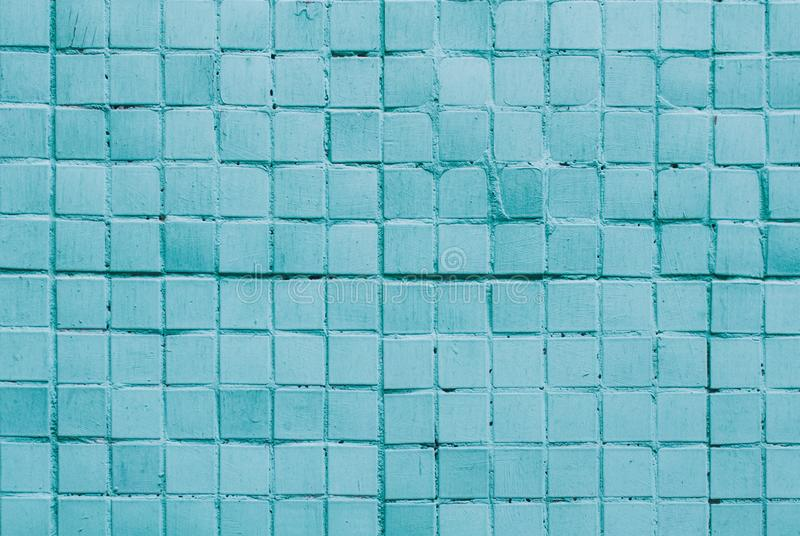 Texture of old tile wall. Background of Wall fragment with uneven tile. Texture of old blue tile wall. Background of Wall fragment with uneven tile royalty free stock images