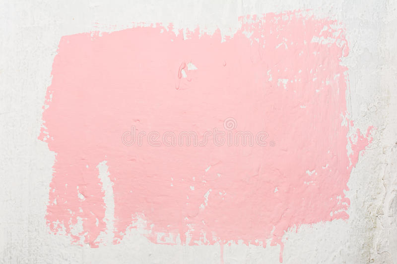 Texture of an old uneven white wall with an abstract spot of pink color, painted with a brush using dispersion stock photos