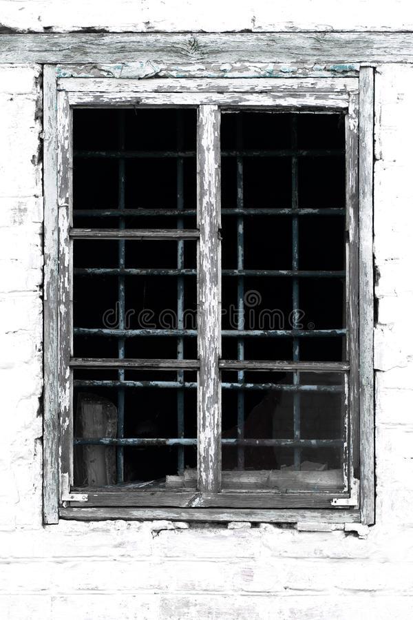 Texture of an old vintage window in a wooden frame against a whi stock photos